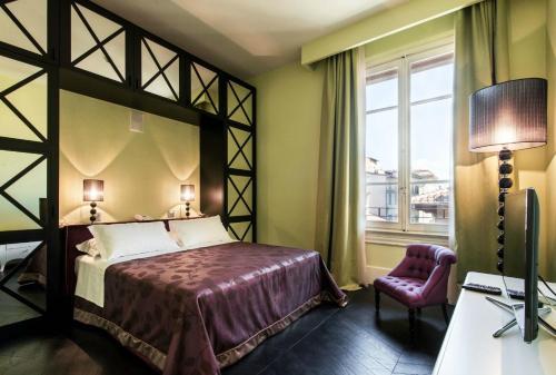 Letto o letti in una camera di Cavalieri Palace Luxury Residences