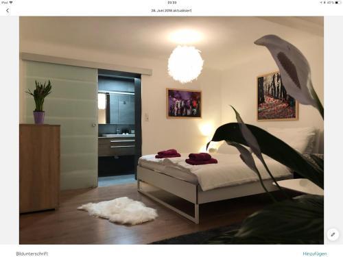 Ein Bett oder Betten in einem Zimmer der Unterkunft PIXI Apartment