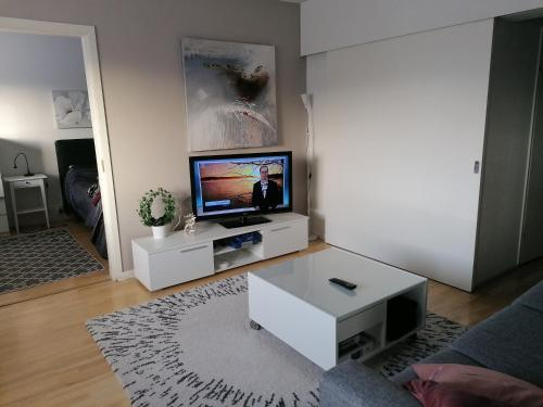 A television and/or entertainment center at Peaceful City Centre Apartment (2 Bdr)