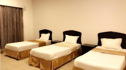 A bed or beds in a room at Al Nasriah Al Oula Furnished Units-For Families