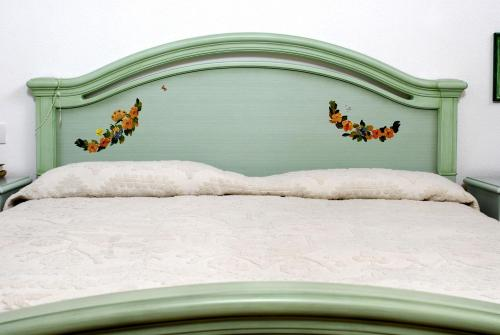 A bed or beds in a room at Villa Monte Moro ''Azzi Russi''