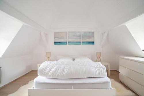 Ein Bett oder Betten in einem Zimmer der Unterkunft LOFT