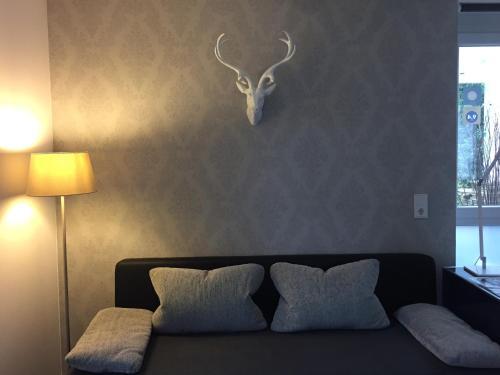 Ein Sitzbereich in der Unterkunft Apartment End