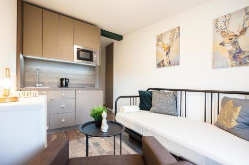 Un ou plusieurs lits dans un hébergement de l'établissement Rent-Apart Fabryczna