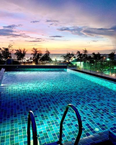 Swimming pool at or nearby Karon Beach Family Hotel
