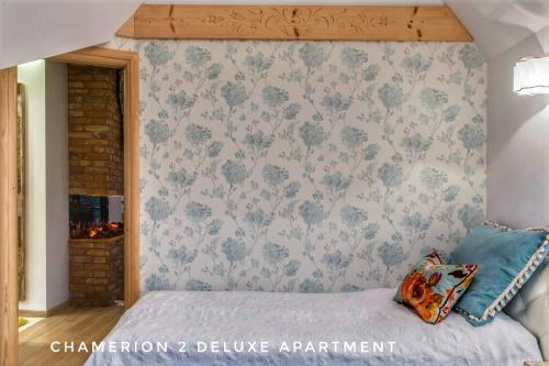 A bed or beds in a room at Polana Szymoszkowa Ski Resort - Chamerion Apartments