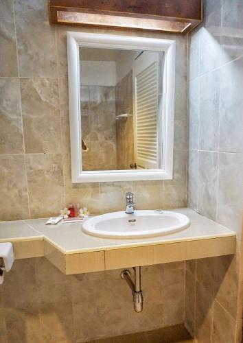 Ein Badezimmer in der Unterkunft Scaperesort
