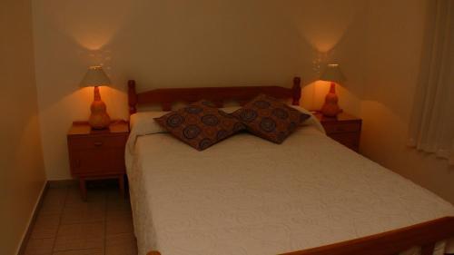 Una cama o camas en una habitación de Cabañas en Barrio San Bernardo