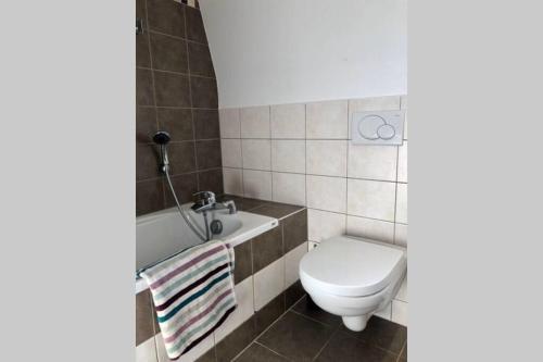 Ein Badezimmer in der Unterkunft L'Alsacien