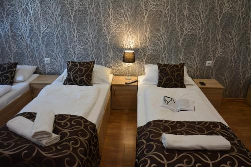 Łóżko lub łóżka w pokoju w obiekcie Podhalanin noclegi