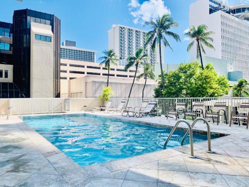The swimming pool at or near Tropical Studios at Marine Surf Waikiki