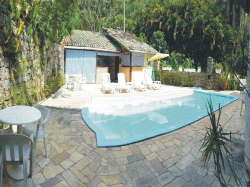 The swimming pool at or near Casa do Joca - Ilhabela