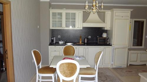 A kitchen or kitchenette at Grand Monastery Hotel Apartments
