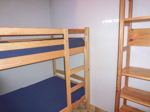 A bunk bed or bunk beds in a room at Apartment La Lagune.5