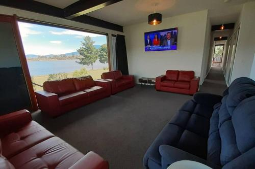 A seating area at Hobart Waterfront Luxury Retreat