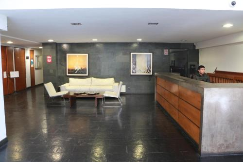 El vestíbulo o zona de recepción de Austral Rentahome Santa Beatriz