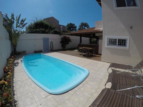Piscina en o cerca de Casa 4 dormitórios, piscina