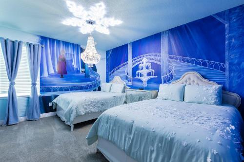A bed or beds in a room at Luxury Villas in Encore Waterpark