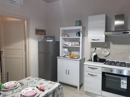 A kitchen or kitchenette at AL GELSOMINO