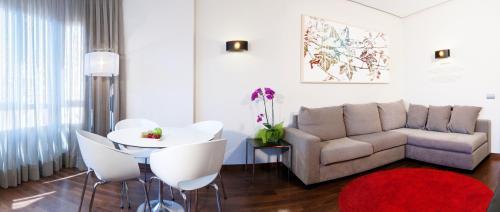 Zona d'estar a Apartosuites Jardines de Sabatini