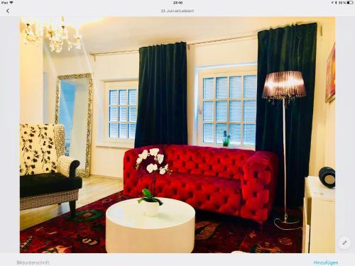 Ein Sitzbereich in der Unterkunft Max-Apartment