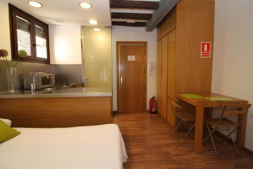 A kitchen or kitchenette at BCN2STAY Apartments