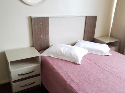 A bed or beds in a room at Camburiu Apartamento Frente al Mar