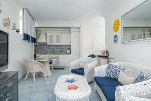 A seating area at Positano Luxury Villas