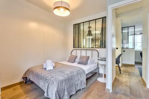 Cama ou camas em um quarto em 29 Best Flat Paris Marais