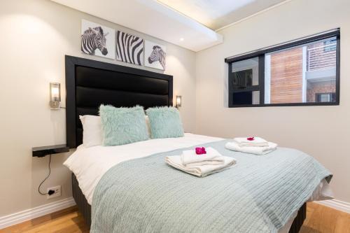 Un ou plusieurs lits dans un hébergement de l'établissement The Docklands 509 by CTHA