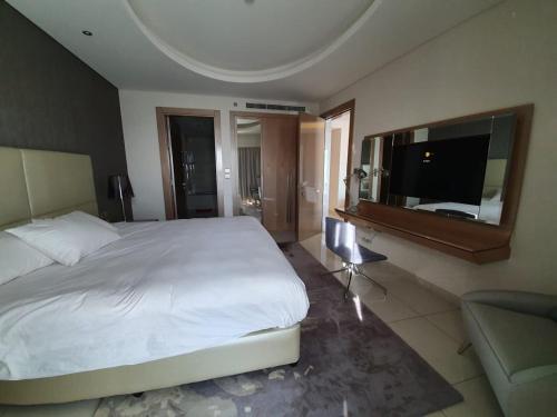 Ein Bett oder Betten in einem Zimmer der Unterkunft Damac Royale