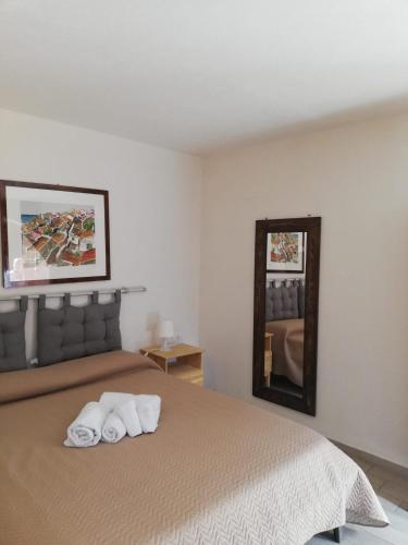 A bed or beds in a room at B&B Villa Antonella