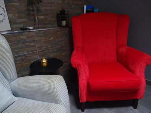 A seating area at Apartment My Home