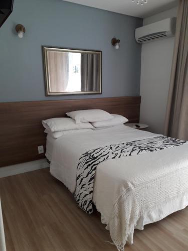 Cama o camas de una habitación en Ap pe na areia em ingleses - Florianópolis SC