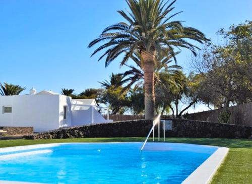 The swimming pool at or near Villas Lanzasuites