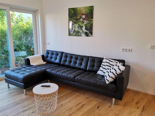 A seating area at Großzügiges Appartement in der Nähe von Baden-Baden