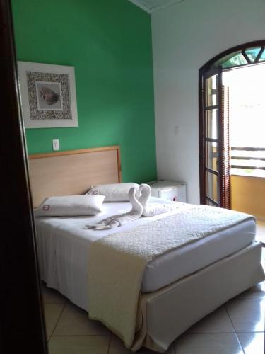 A bed or beds in a room at Pousada Alentejano Toninhas