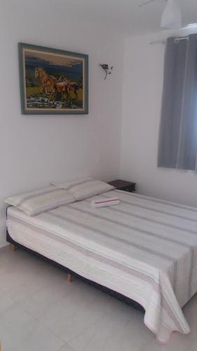 A bed or beds in a room at Apto imperdível !