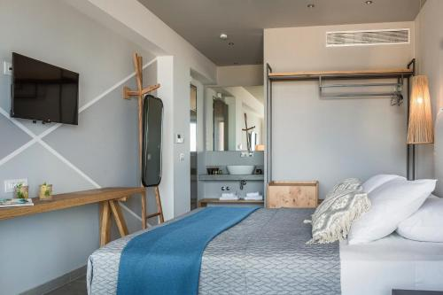 A bed or beds in a room at Asteris Hotel