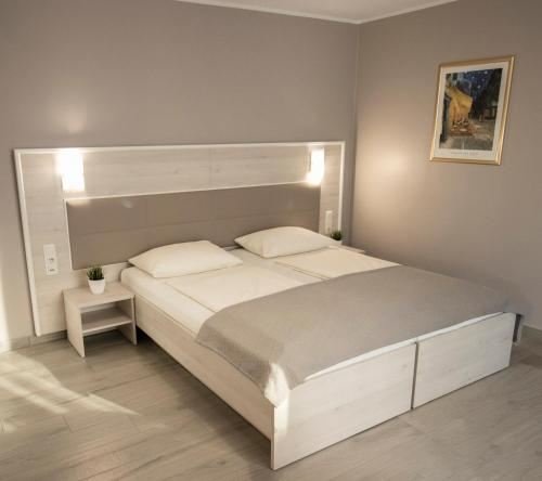 A bed or beds in a room at ARABEST Aparthotel