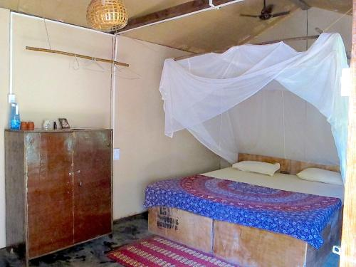 A bed or beds in a room at Galaxy Jungle Huts