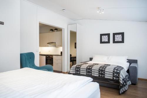 Een bed of bedden in een kamer bij Rey Apartments