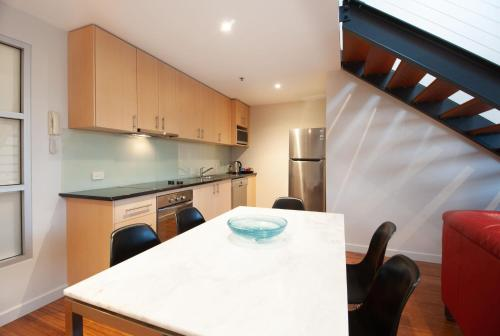 A kitchen or kitchenette at Semaphore Blue Apartments