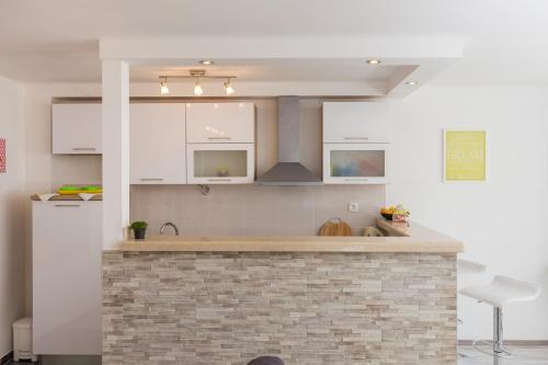 A kitchen or kitchenette at Guest House Godimento