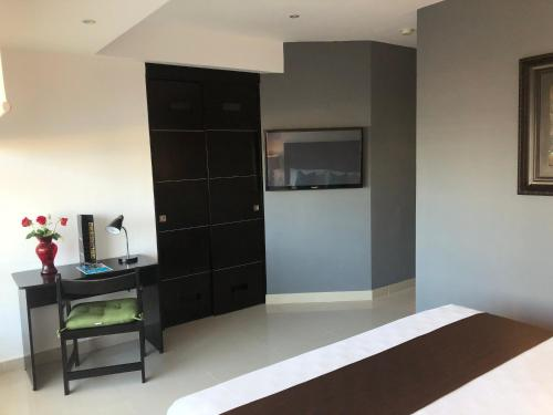 A television and/or entertainment center at Suites Malecon Cancun