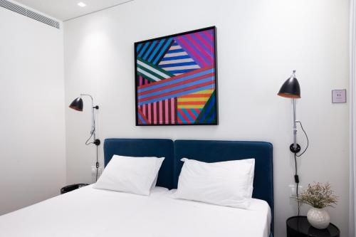 A bed or beds in a room at BessaApartments