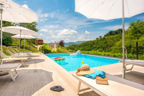 The swimming pool at or close to Canapegna Village - private villas and 2 pools in the heart of Le Marche