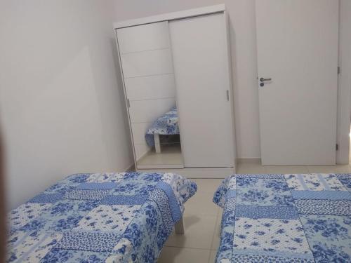 Cama o camas de una habitación en Apartamento ar condicionado