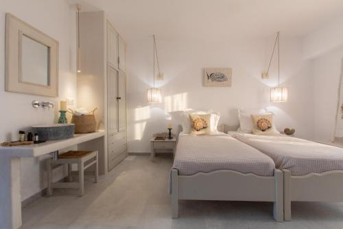 A bed or beds in a room at Studios Athina Plaka