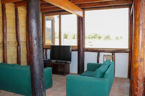 Zona de estar de Bungalows Canoas de Punta Sal